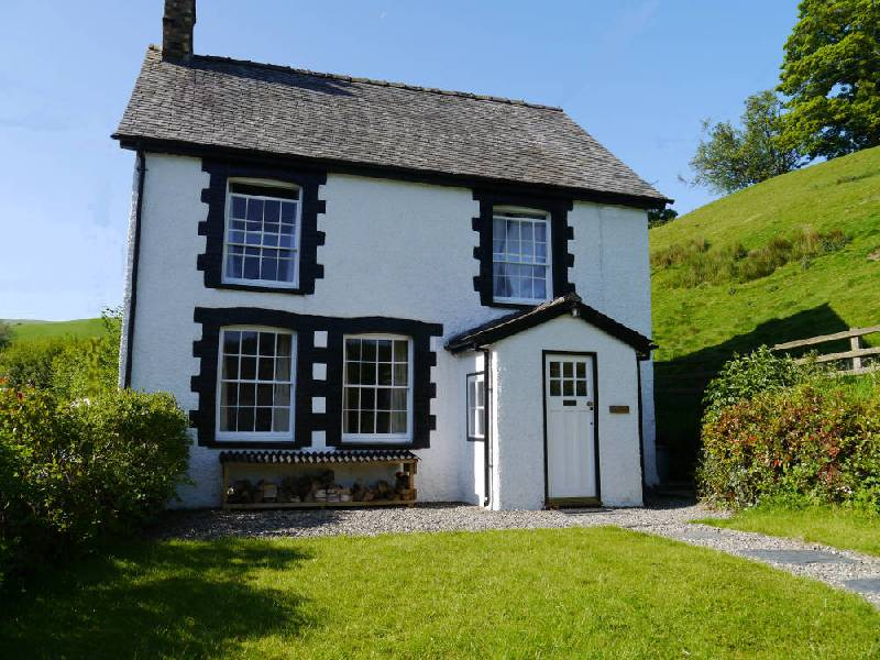Glan y Wern holiday cottage sleeping four in a pretty village in North Wales - cyclist owned!